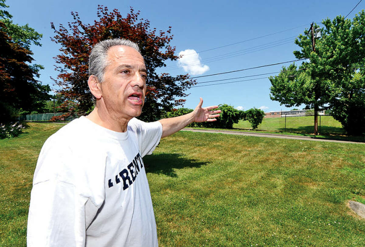 Hour photo / Erik Trautmann The Norwalk Zoning Commission may vote next Wednesday on a plan for athletic field lighting for Nathan Hale Middle School. Some neighbors, including Richard Kestenbaum, are frowing upon the proposal.