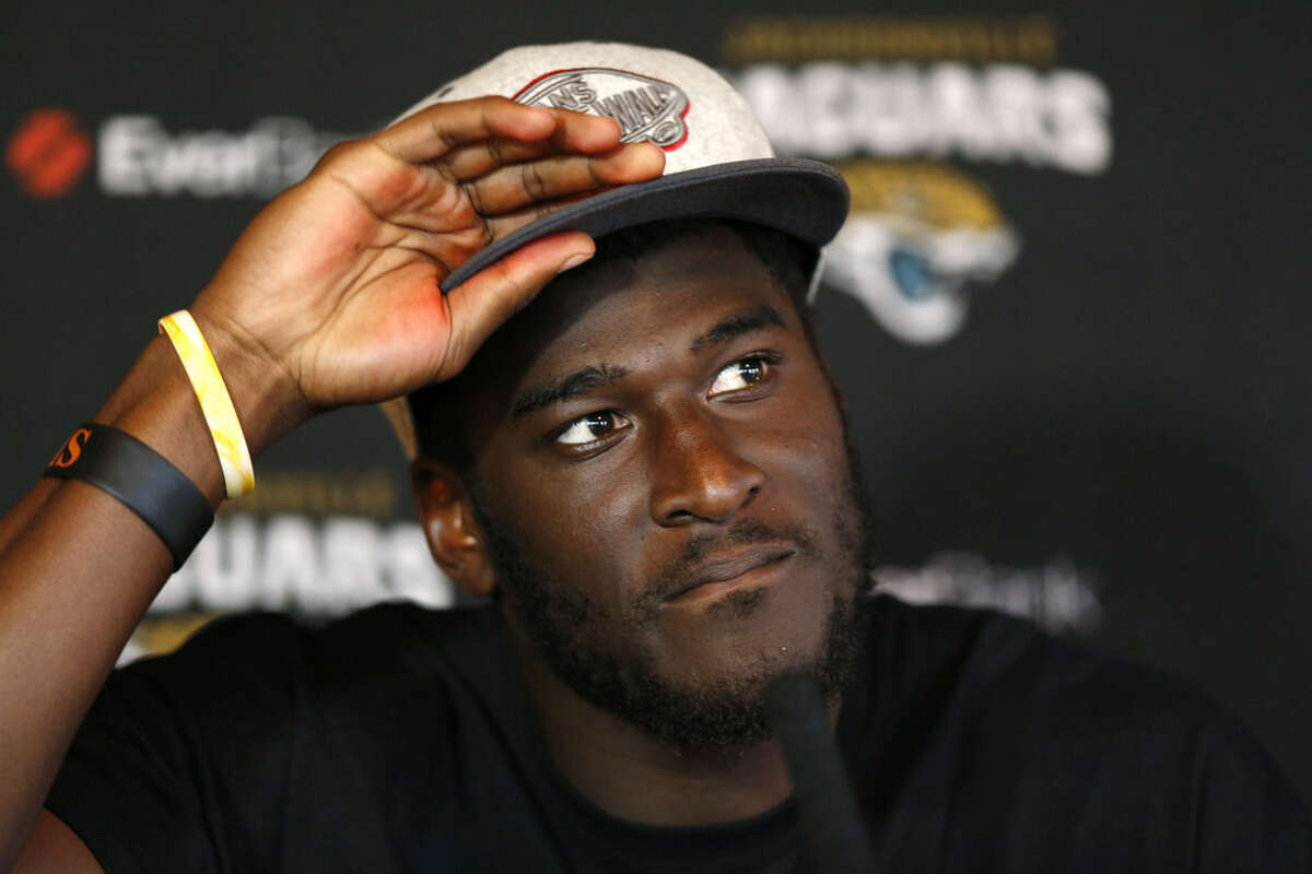 FILE - In this Oct. 23, 2013 file photo, Jacksonville Jaguars wide receiver Justin Blackmon speaks to the media during a press conference at the Pennyhill Park Hotel and Spa in Bagshot, England. Jaguars general manager Dave Caldwell said Tuesday, Aug. 4, 2015, that he has a