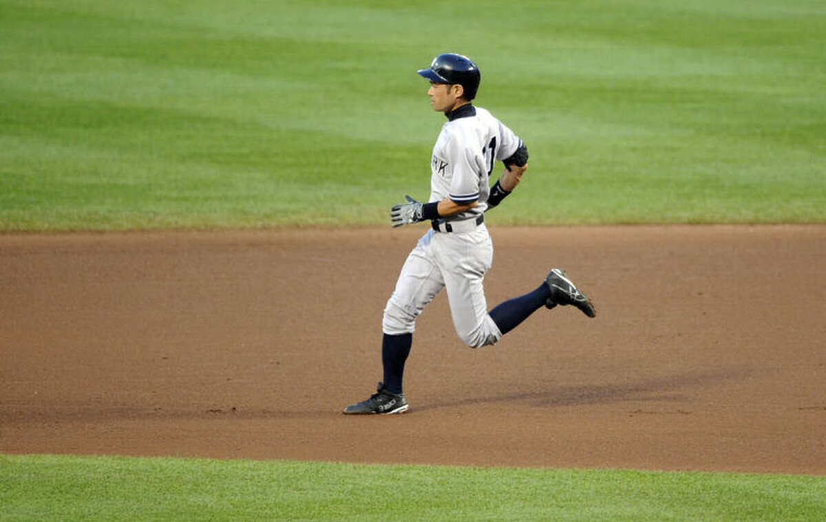New York Yankees' Ichiro Suzuki, of Japan, runs towards second for a double during the fourth inning of a baseball game, Friday, July 11, 2014, in Baltimore. (AP Photo/Nick Wass)
