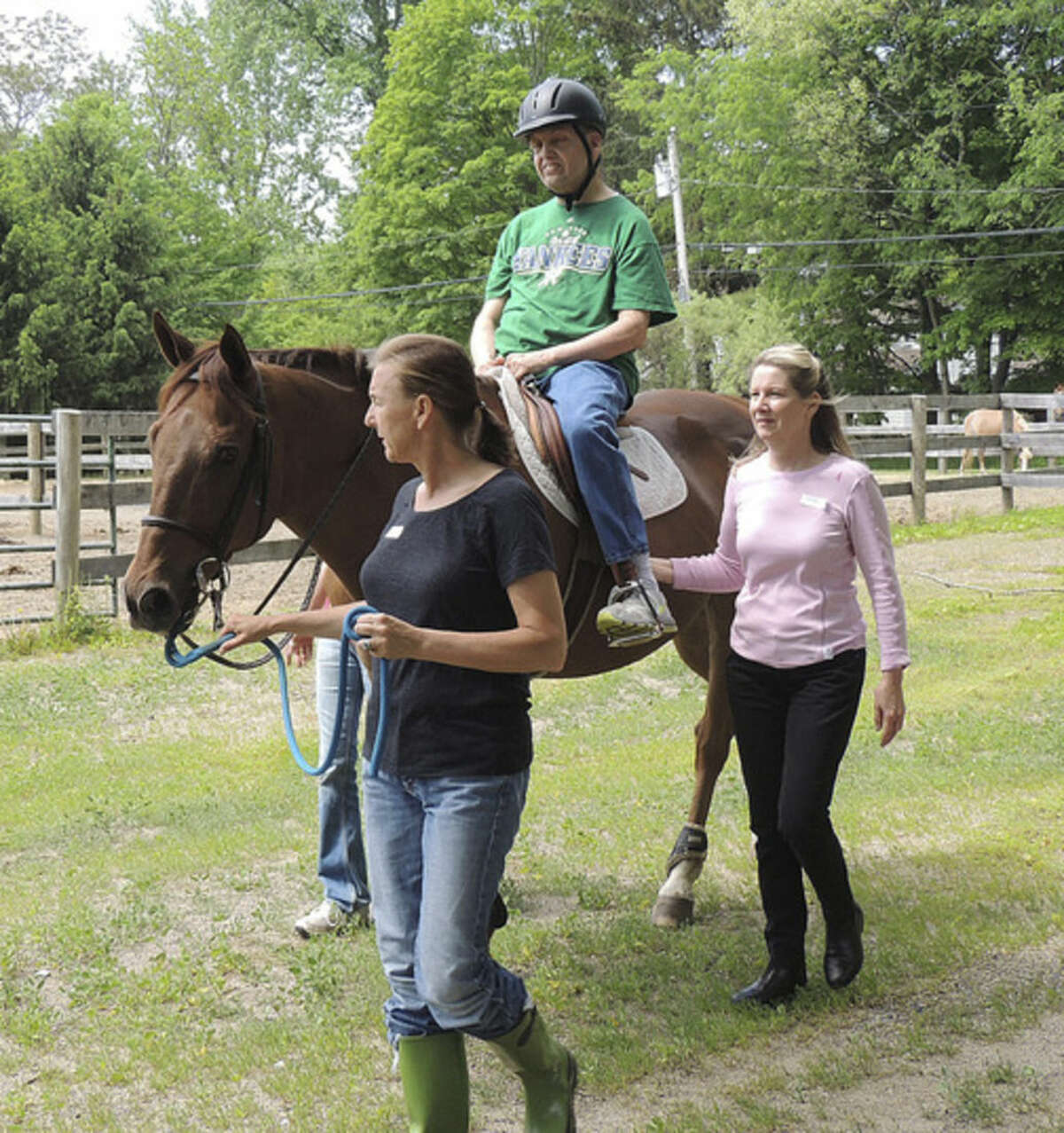 Contributed photo Norwalker Steven Denittis of STAR rides a horse with help from his teachers at New Canaan Mounted Troop.