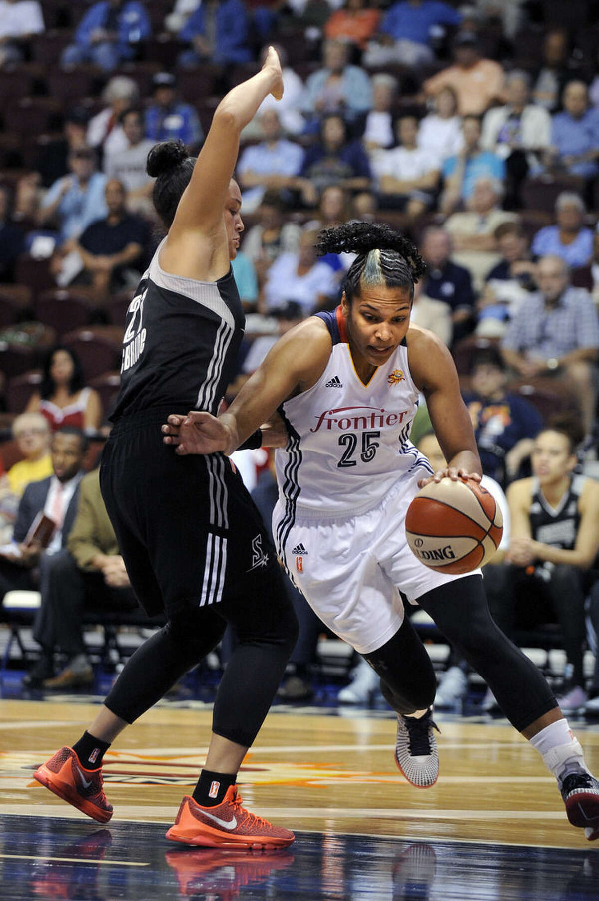 Connecticut Sun's Alyssa Thomas (25) drives past San Antonio Stars's Kayla McBride (21) during the first half of a WNBA basketball game in Uncasville, Conn., on Tuesday, Aug. 4, 2015. (AP Photo/Fred Beckham)