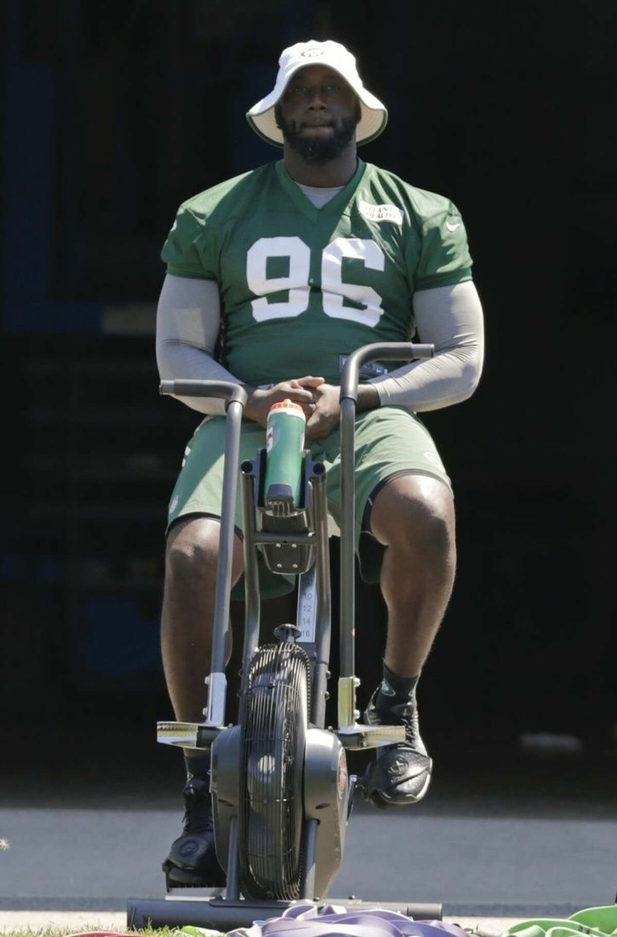 New York Jets' Muhammad Wilkerson rides a stationary bike during practice at NFL football training camp, Tuesday, Aug. 4, 2015, in Florham Park, N.J. (AP Photo/Frank Franklin II)