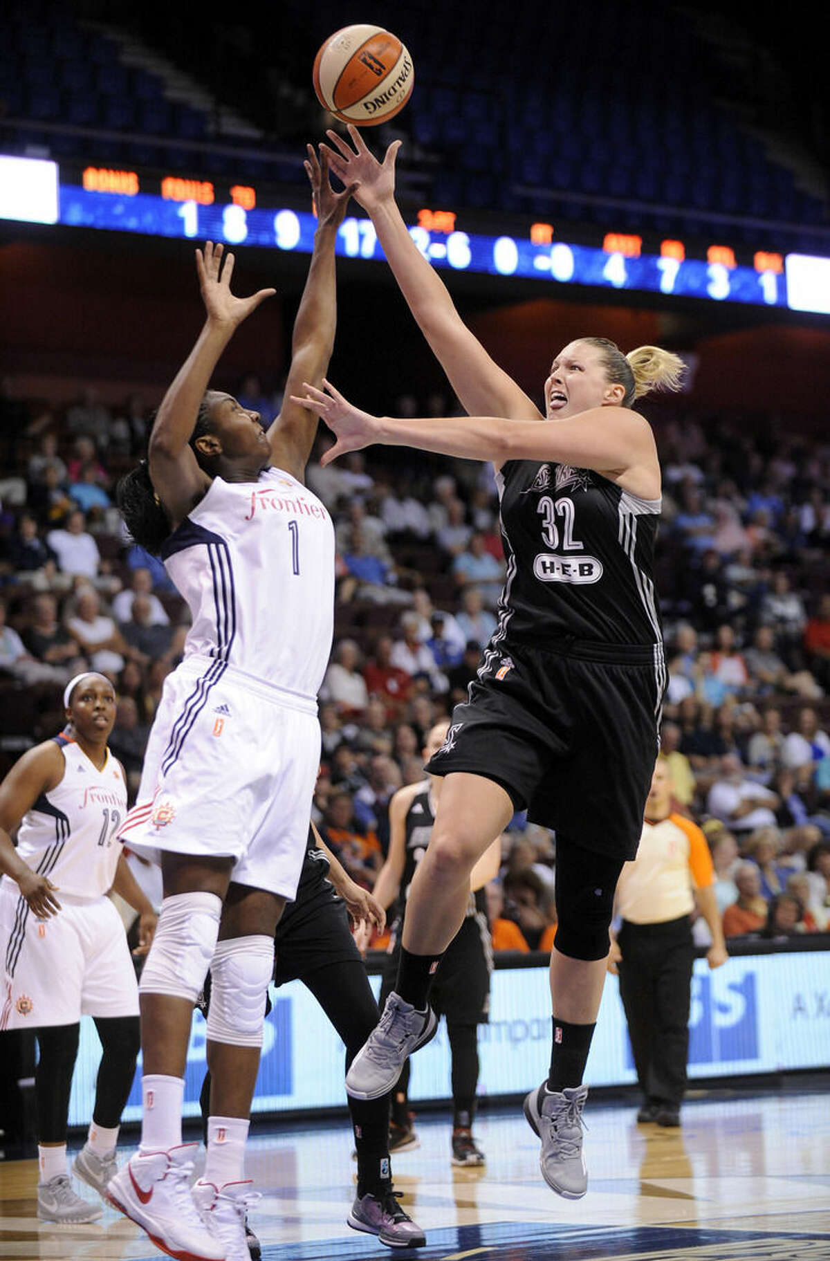 San Antonio Stars's Jayne Appel (32) shoots over Connecticut Sun's Elizabeth Williams (1) during the first half of an WNBA basketball game in Uncasville, Conn., on Tuesday, Aug. 4, 2015. (AP Photo/Fred Beckham)
