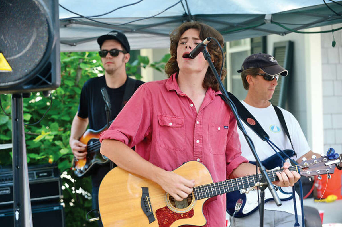 Hour photo / Erik Trautmann James Crafford sings with Peter Stewart and Friends at the 44th Annual River Ramble at Pinkney Park Saturday.