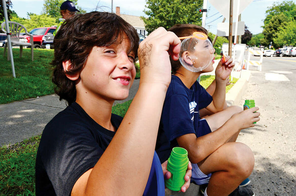 Hour photo / Erik Trautmann 8 year old Lorenzo Caratozzolo blows bubbles with his friends during the 3rd annual Wilton Street Fair and Sidewalk Sale in Wilton Center Saturday.
