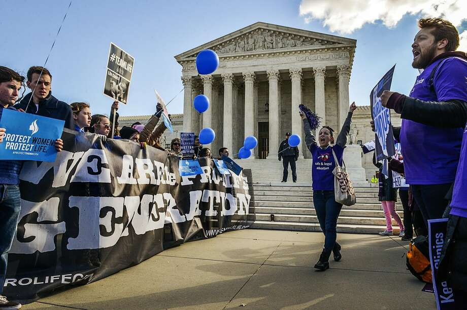 Anti-abortion demonstrators and abortion rights supporters face off outside the Supreme Court. Photo: Bill O'Leary, Washington Post
