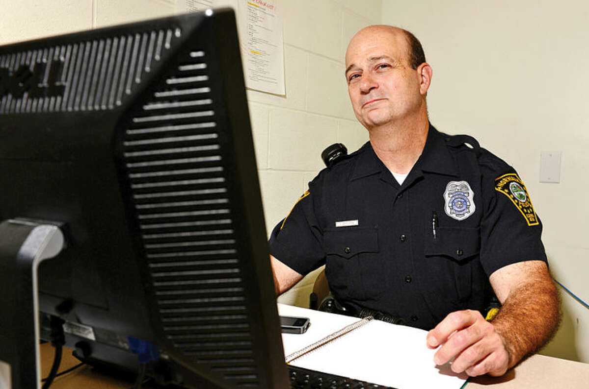 Hour photo / Erik Trautmann Norwalk police officer Cornell Abruzzini.