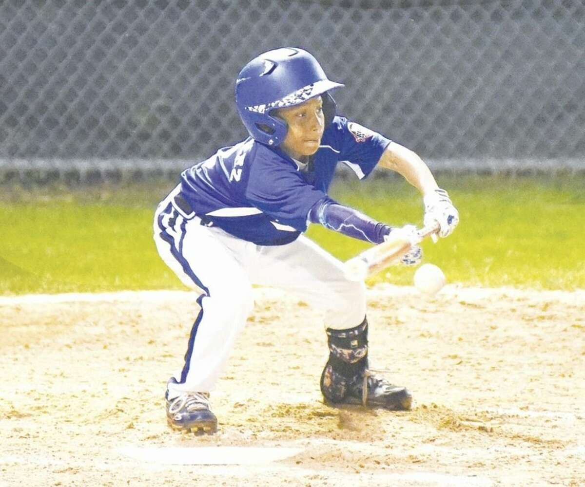 Hour photo/John Nash Norwalk's Jayden Gonzalez looks to lay down a bunt during Tuesday's winners bracket final against Newtown at the New England Cal Ripken Regional 11-year-old All-Stars tournament at Beckwith Park in Dover, N.H. Newtown defeated Norwalk, 3-2.