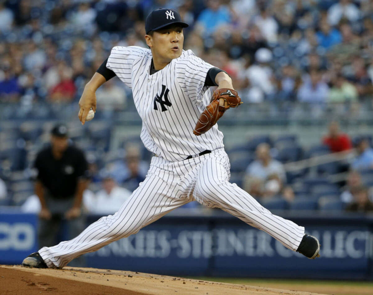 New York Yankees starting pitcher Masahiro Tanaka delivers in the first inning of a baseball game against the Boston Red Sox at Yankee Stadium in New York, Tuesday, Aug. 4, 2015. (AP Photo/Kathy Willens)