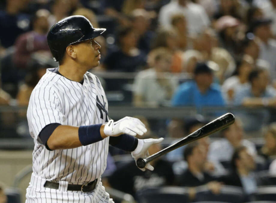 New York Yankees designated hitter Alex Rodriguez drops his bat as he watches his sixth-inning double off Boston Red Sox starting pitcher Henry Owens during a baseball game at Yankee Stadium in New York, Tuesday, Aug. 4, 2015. (AP Photo/Kathy Willens)