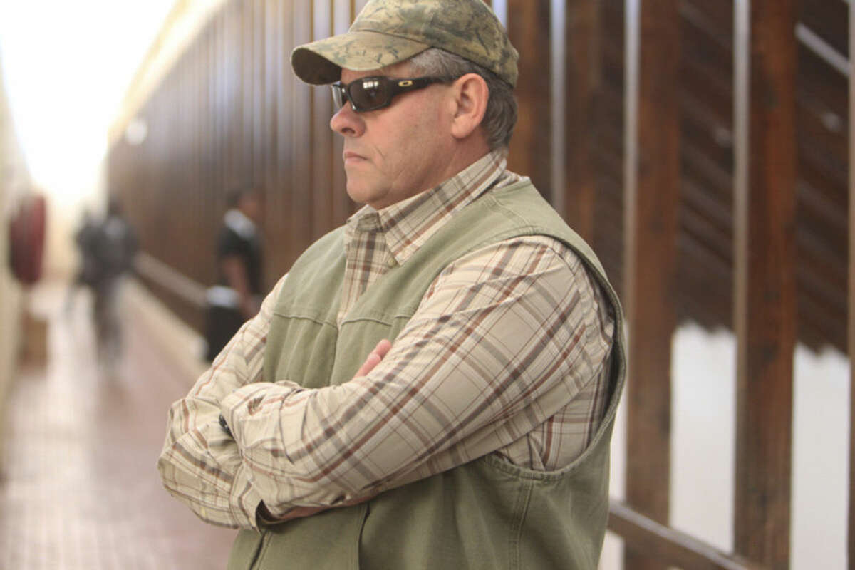 Professional hunter Theodore Bronkhorst prepares to enter the magistrates courts to face trial in Hwange about 700 kilometres south west of Harare, Zimbabwe, Wednesday, Aug. 5, 2015. The trial of a professional hunter who helped an American kill a popular lion named Cecil in an allegedly illegal hunt in Zimbabwe has been postponed to Sept. 28. Theo Bronkhorst appeared Wednesday in a court in Hwange town, where he faces charges of failing to prevent an unlawful hunt. If convicted, he faces up to 15 years in prison. (AP Photo/Tsvangirayi Mukwazhi)