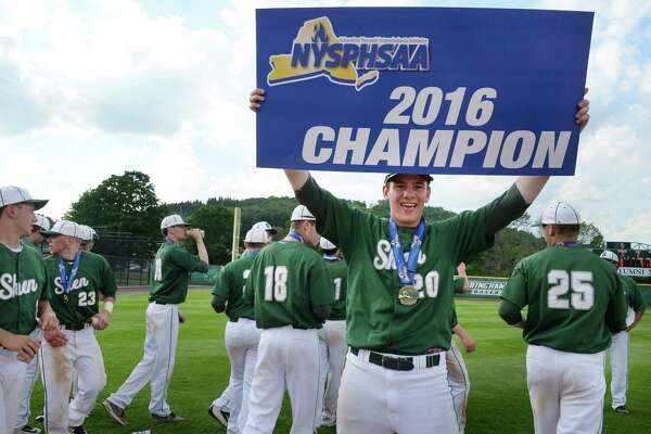 Shen's #20 Matt Straney holds up the Class AA state championship sign after their win over Webster Schroeder Saturday June 11, 2016 in Binghamton, NY.   (John Carl D'Annibale / Times Union)
