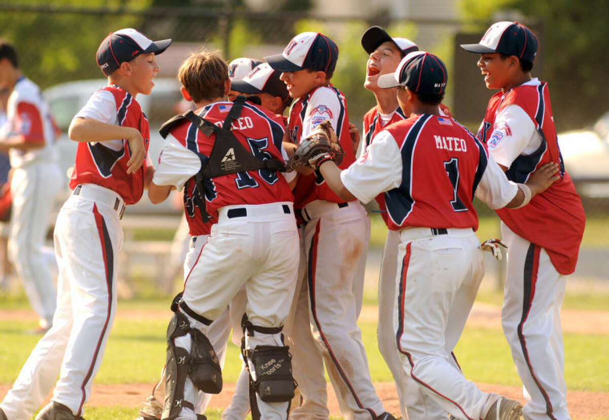 The Norwalk Little League 12-year-old All-Stars celebrate their District 1 championship, which they won on Saturday with a 14-5 win over North Stamford.