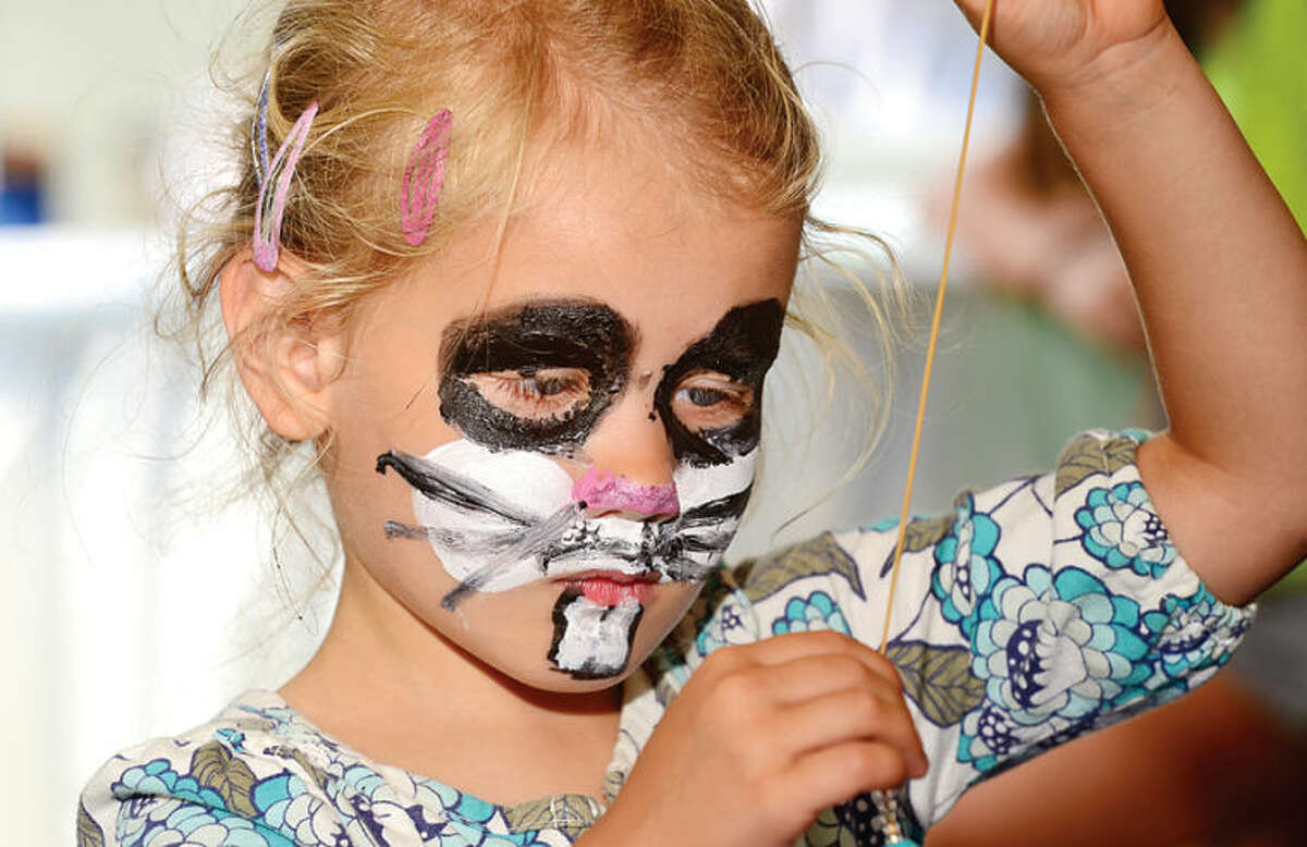 Hour photo / Erik Trautmann 3 year old Pollyanna Seidel enjoys the craft table at the 44th Annual River Ramble at Pinkney Park Saturday.