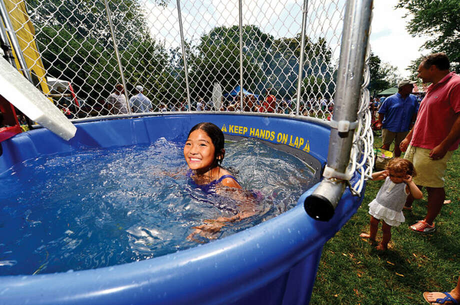 Hour photo / Erik Trautmann 9 year old Kate Min enjoys the dunk tank at the 44th Annual River Ramble at Pinkney Park Saturday.