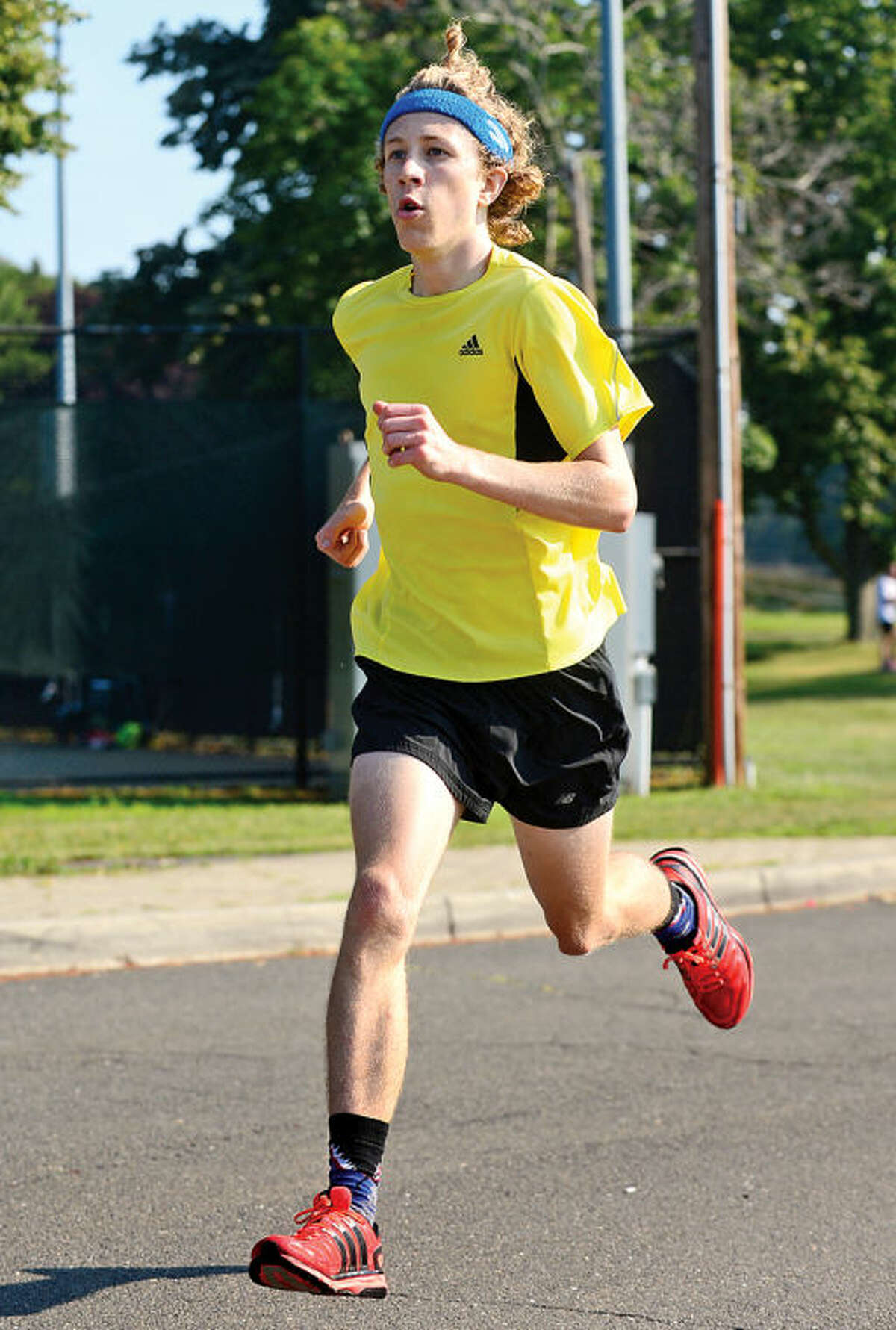 Hour photo / Erik Trautmann Spencer Brown finishes first in the Westport Road Runners race no. 3, a 3.8 miler, at Longshore Park Saturday