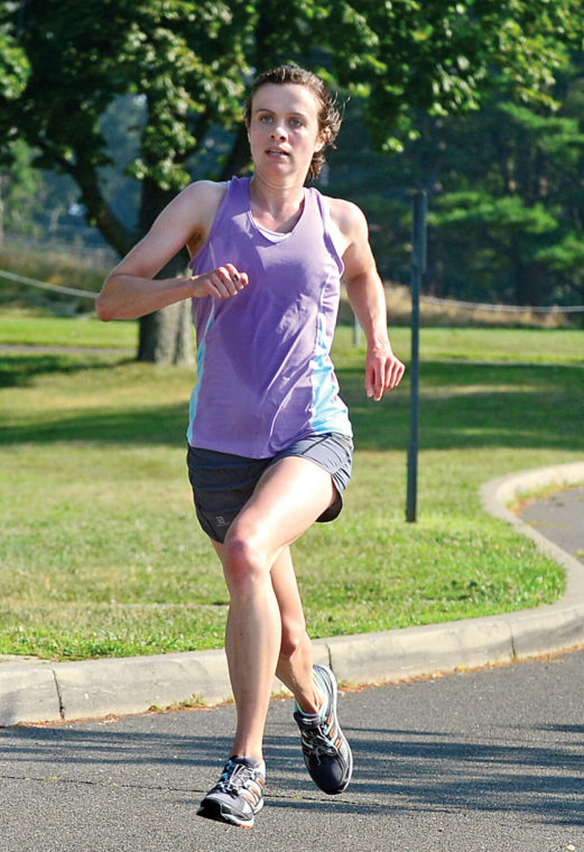 Hour photo / Erik Trautmann Kerry Lyons was the first woman finisher in the Westport Road Runners race no. 3, a 3.8 miler, at Longshore park Saturday.