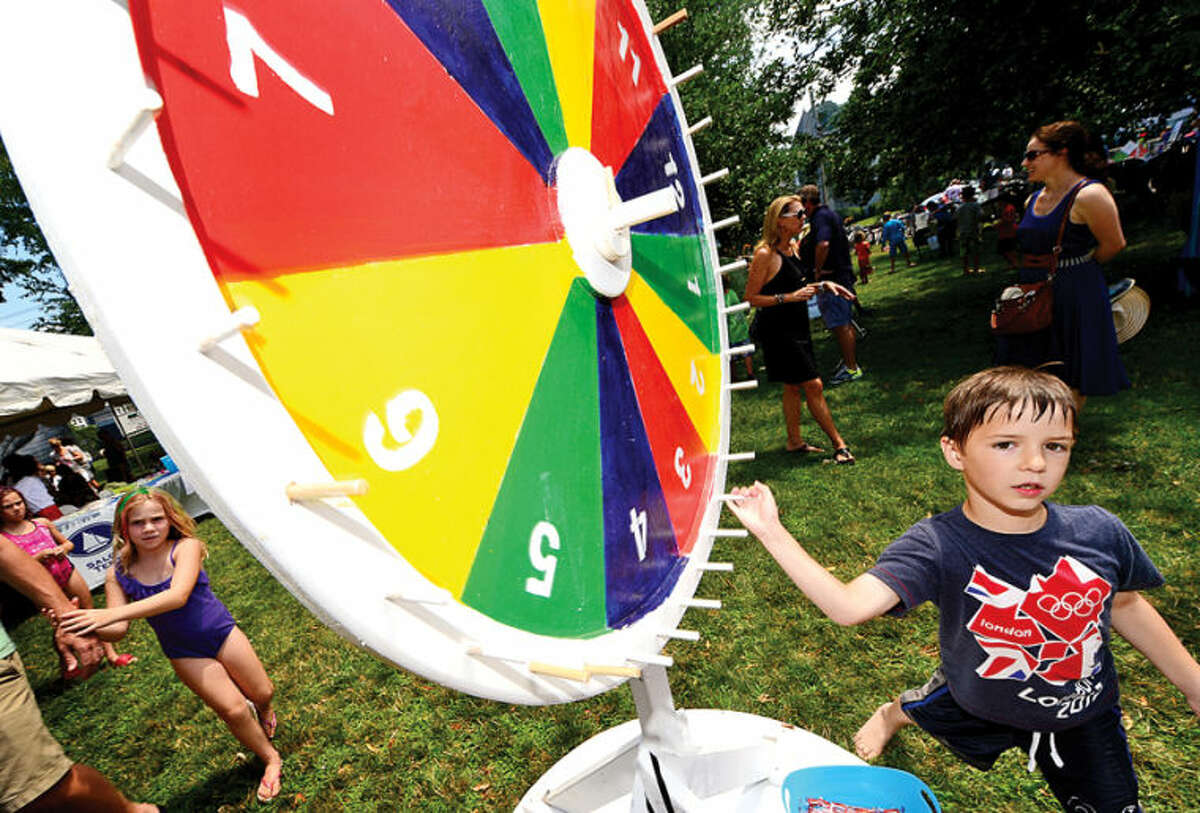 Hour photo / Erik Trautmann 7 year old James herbert tries his luck at the 44th Annual River Ramble at Pinkney Park Saturday.