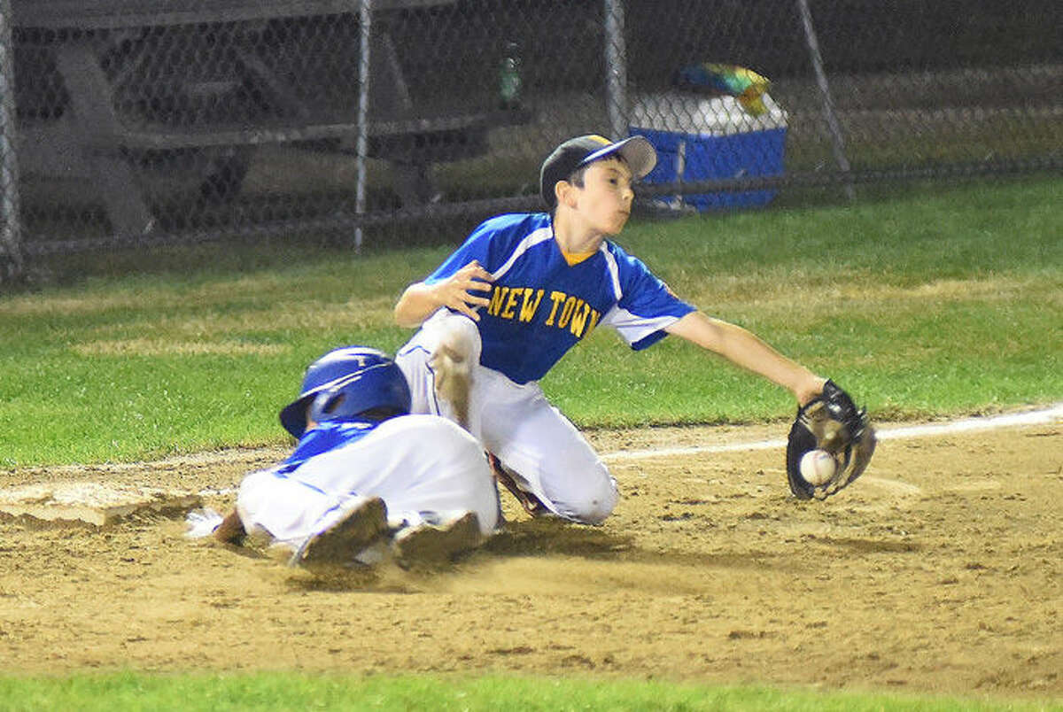Action from Tuesday's Norwalk 11-year-old Cal Ripken New England regional game vs. Newtown, at Keyes Field in Dover, N.H. Newtown won, 3-2.