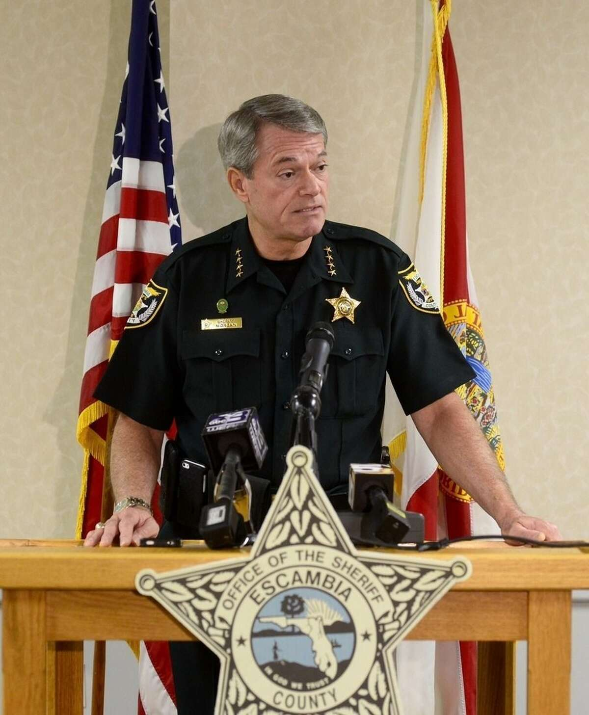 Escambia County Sheriff David Morgan speaks at a news conference in Pensacola, Fla., Tuesday, Aug. 4, 2015. Morgan said a triple homicide in Florida is being investigated as a possible ritualistic killing connected to the recent blue moon. (Ben Twingley, Pensacola News Journal via AP)