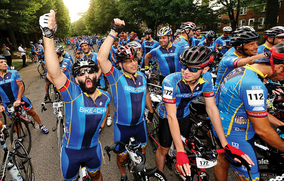 More than 400 cyclists from across the United States and Canada, including Laibi Freumzlich and Leibi Schwimmer, participate in the annual 2015 Bike4Chai event in Stamford Wednesday morning. The group raised $5 million for Camp Simcha, an overnight summer camp for children with cancer, chronic conditions, genetic illnesses and disabilities. The first day of the ride will consist of 100 miles through Connecticut and Northern New Jersey (total climb: 7,500 feet). The second day will consist of 65 miles through New Jersey and New York (total climb: 4,500 feet).