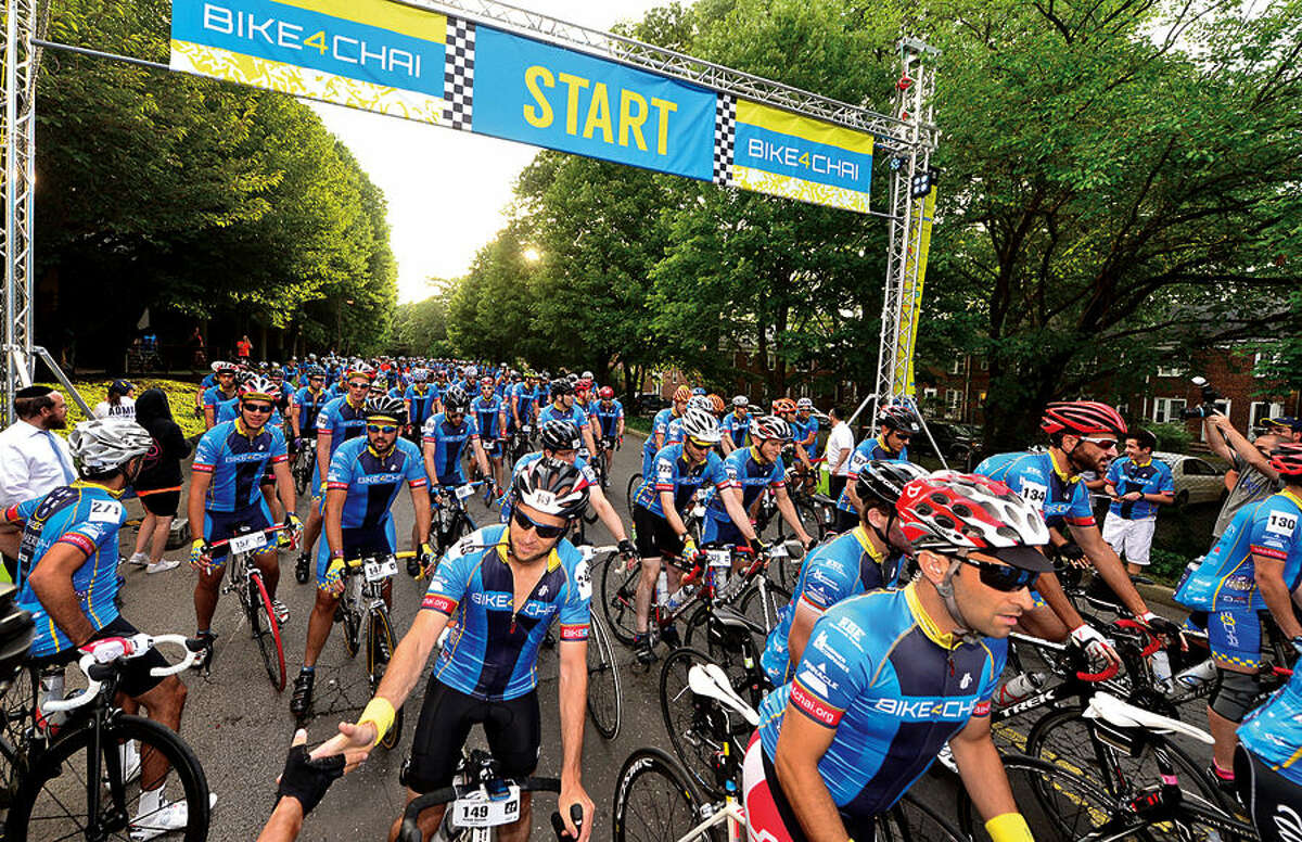 More than 400 cyclists from across the United States and Canada participate in the annual 2015 Bike4Chai event in Stamford Wednesday morning.The group raised $5 million for Camp Simcha, an overnight summer camp for children with cancer, chronic conditions, genetic illnesses and disabilities. The first day of the ride will consist of 100 miles through Connecticut and Northern New Jersey (total climb: 7,500 feet). The second day will consist of 65 miles through New Jersey and New York (total climb: 4,500 feet).