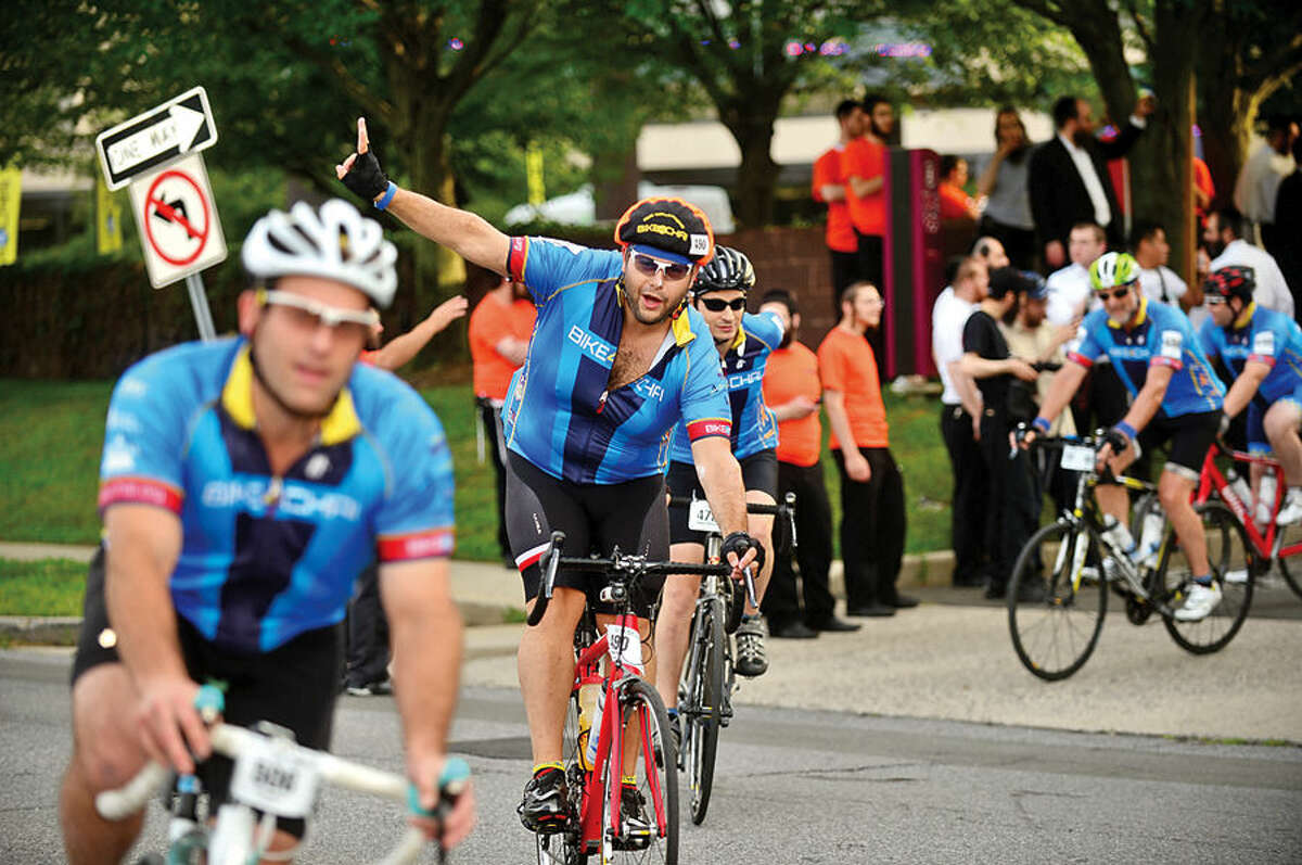 More than 400 cyclists from across the United States and Canada participate in the annual 2015 Bike4Chai event in Stamford Wednesday morning. The group raised $5 million for Camp Simcha, an overnight summer camp for children with cancer, chronic conditions, genetic illnesses and disabilities. The first day of the ride will consist of 100 miles through Connecticut and Northern New Jersey (total climb: 7,500 feet). The second day will consist of 65 miles through New Jersey and New York (total climb: 4,500 feet).