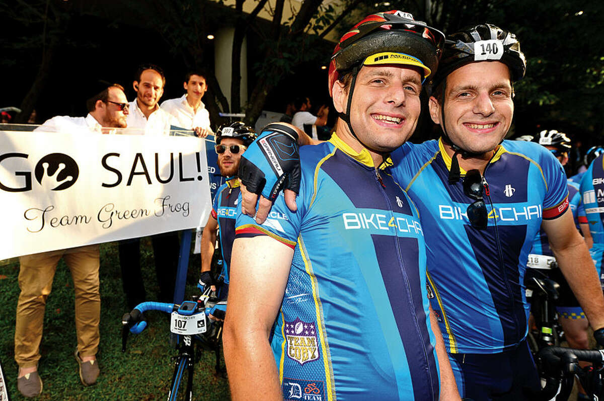 Bike4Chai founder Dovid Egert and his brother Sholen Egert ready themselves for the 165 mile ride Wednesday morning.