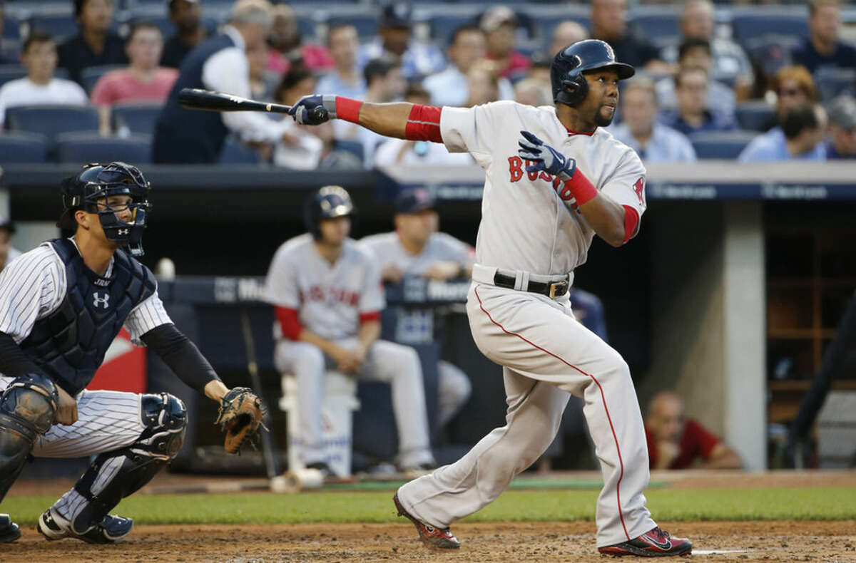 Boston Red Sox's Alejandro De Aza hits an RBI double in front of New York Yankees catcher John Ryan Murphy during the second inning of a baseball game at Yankee Stadium in New York, Wednesday, Aug. 5, 2015. (AP Photo/Kathy Willens)