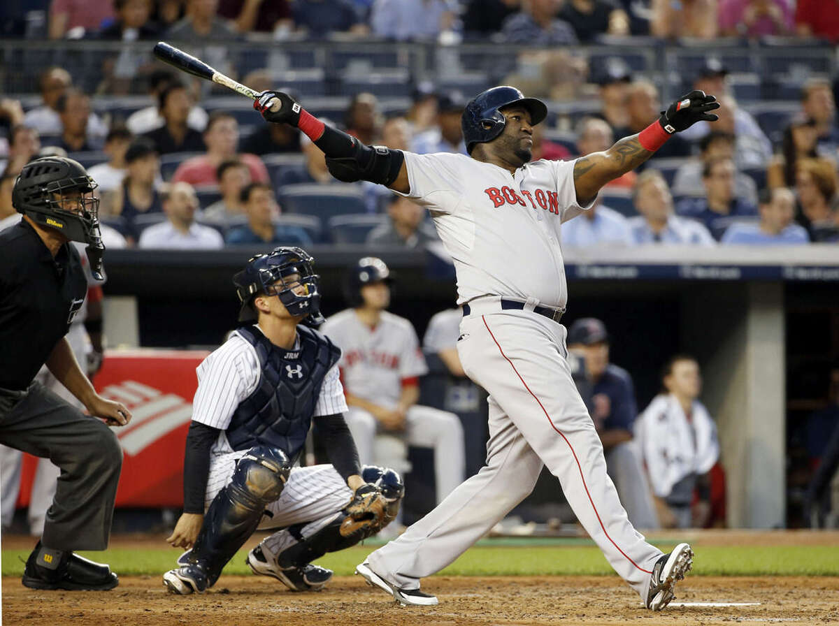 Boston Red Sox's David Ortiz hits a solo home run off New York Yankees starting pitcher Luis Severino as Yankees catcher John Ryan Murphy, middle, watches during the fourth inning of a baseball game at Yankee Stadium in New York, Wednesday, Aug. 5, 2015. (AP Photo/Kathy Willens)