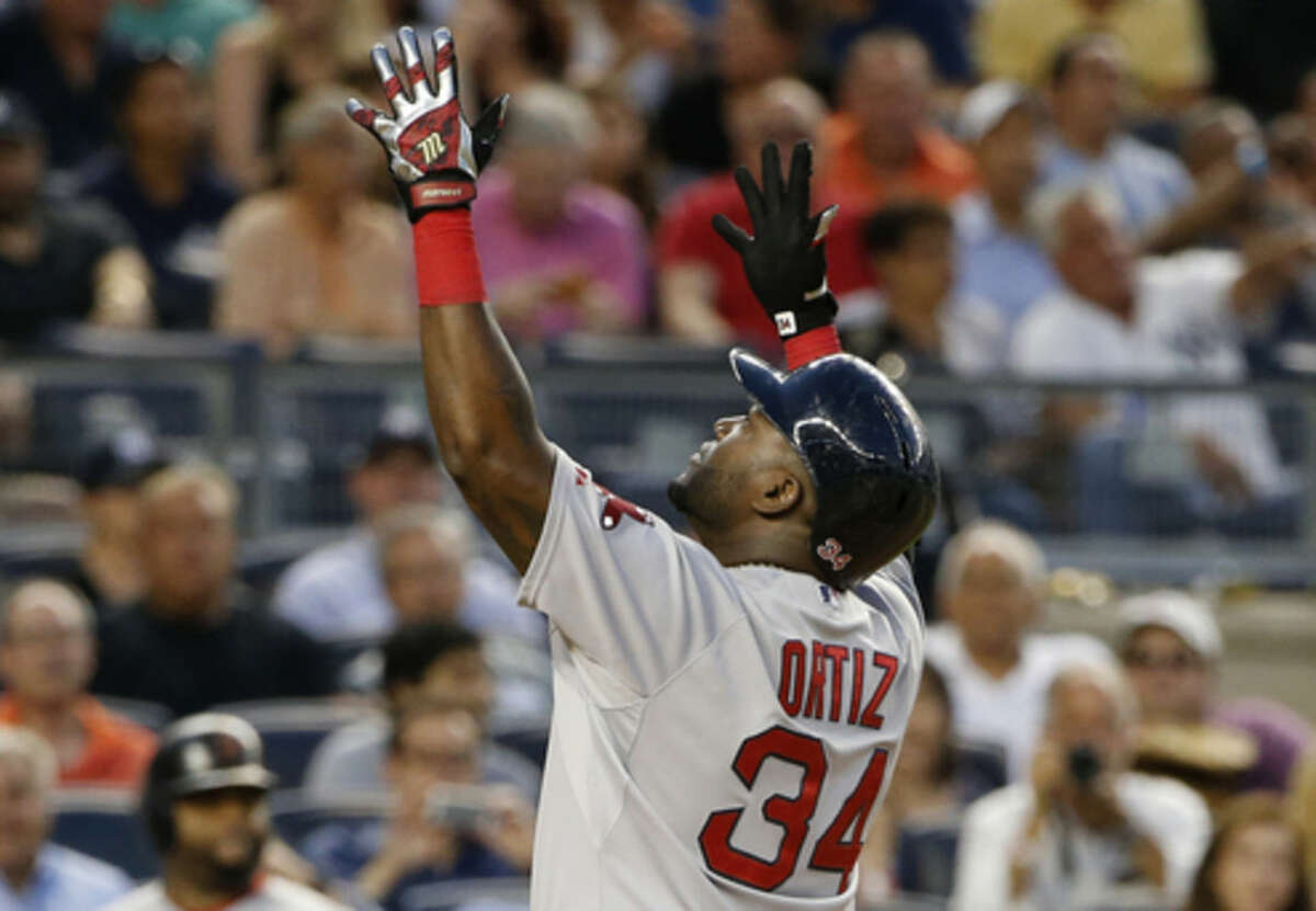 Boston Red Sox designated hitter David Ortiz (34) reacts at the plate after hitting a solo home run off New York Yankees starting pitcher Luis Severino in the fourth inning of a baseball game at Yankee Stadium in New York, Wednesday, Aug. 5, 2015. (AP Photo/Kathy Willens)