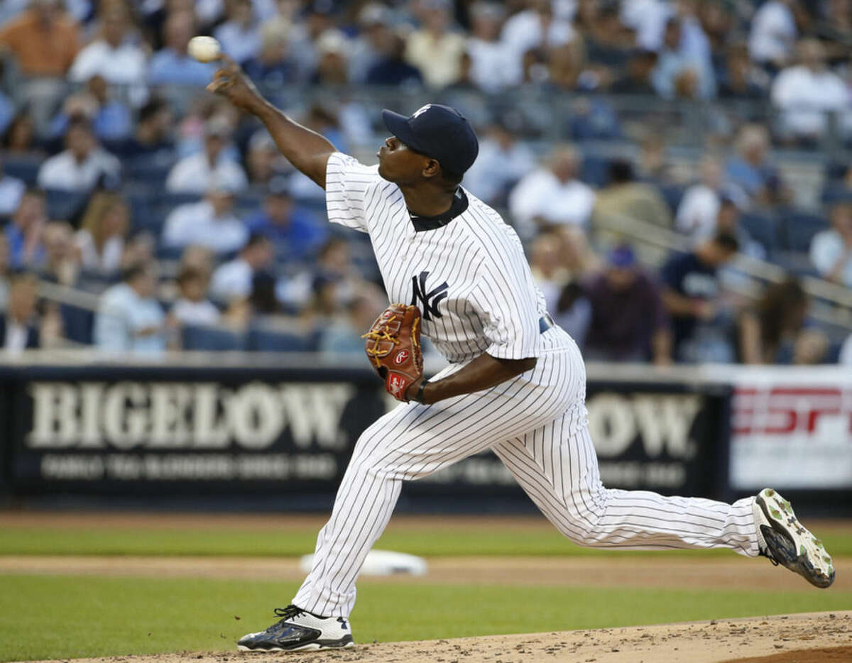 Making his Major League baseball debut, New York Yankees starting pitcher Luis Severino delivers in the second inning of a baseball game against the Boston Red Sox at Yankee Stadium in New York, Wednesday, Aug. 5, 2015. (AP Photo/Kathy Willens)