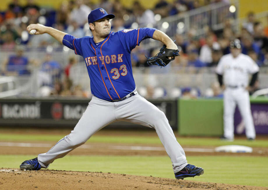 New York Mets starting pitcher Matt Harvey throws against the Miami Marlins during the first inning of a baseball game in Miami, Wednesday Aug. 5, 2015. (AP Photo/Joe Skipper)