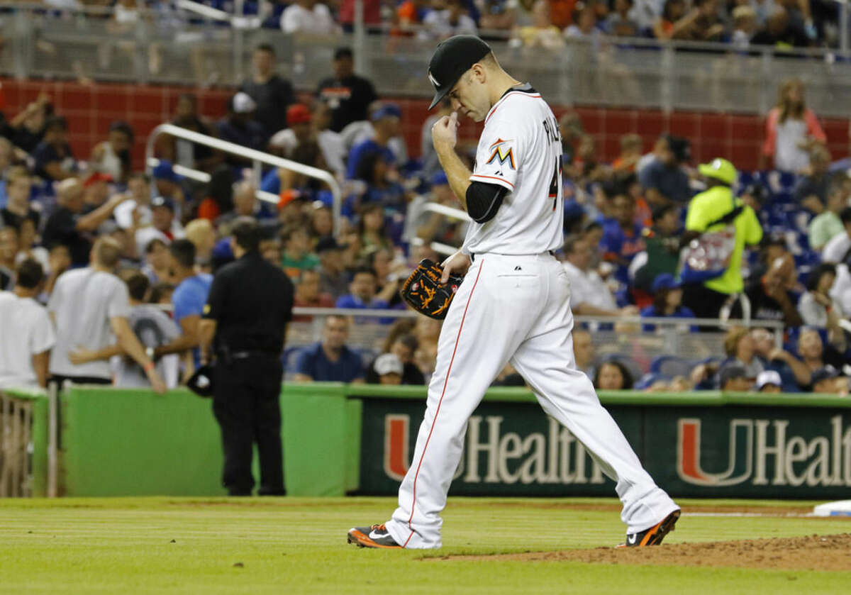 Miami Marlins starting pitcher David Phelps leaves the baseball game in the fifth inning after a home run by New York Mets' Juan Uribe, in Miami, Wednesday Aug. 5, 2015. (AP Photo/Joe Skipper)