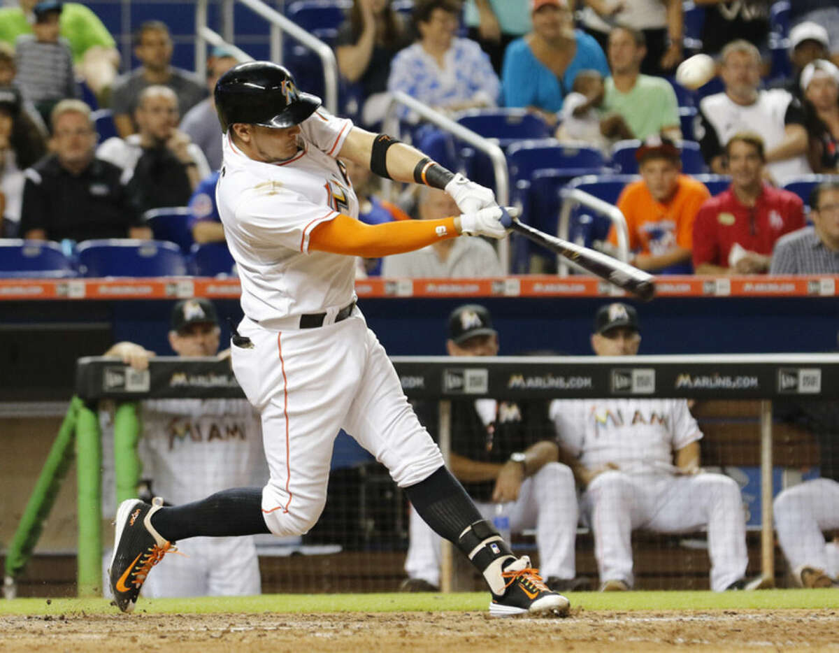Miami Marlins pinch-hitter Miguel Rojas hits a three-run double in the ninth inning against the New York Mets during a baseball game in Miami, Wednesday Aug. 5, 2015. The Mets won 8-6. (AP Photo/Joe Skipper)