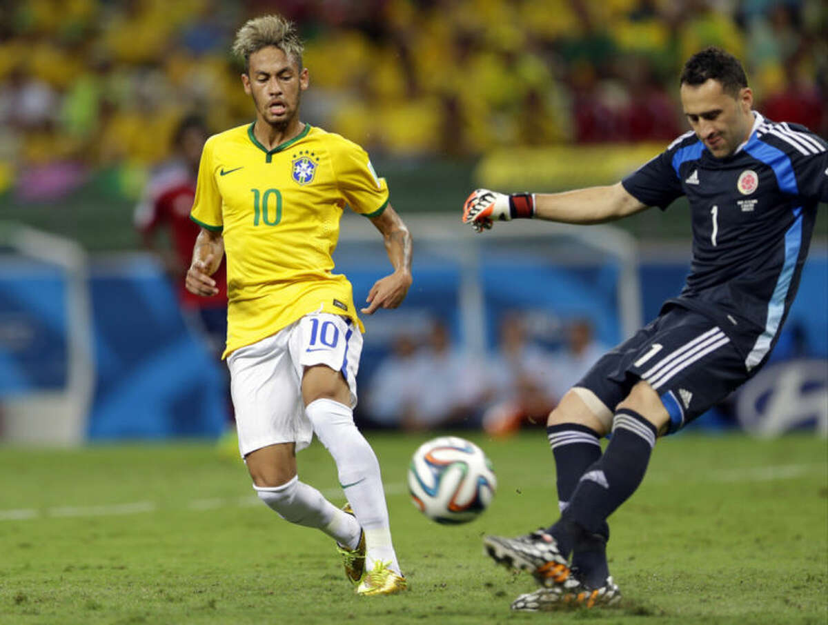 Brazil's Neymar watches as Colombia's goalkeeper David Ospina clears the ball during the World Cup quarterfinal soccer match between Brazil and Colombia at the Arena Castelao in Fortaleza, Brazil, Friday, July 4, 2014. (AP Photo/Andre Penner)
