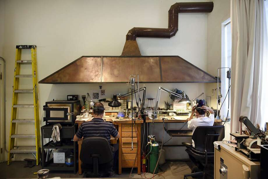 Jewelers Ben Faryna (left) and Nina Bocobo work in the studio area of April Higashi's three-story live-work building in West Berkeley. Photo: Michael Short, Special To The Chronicle