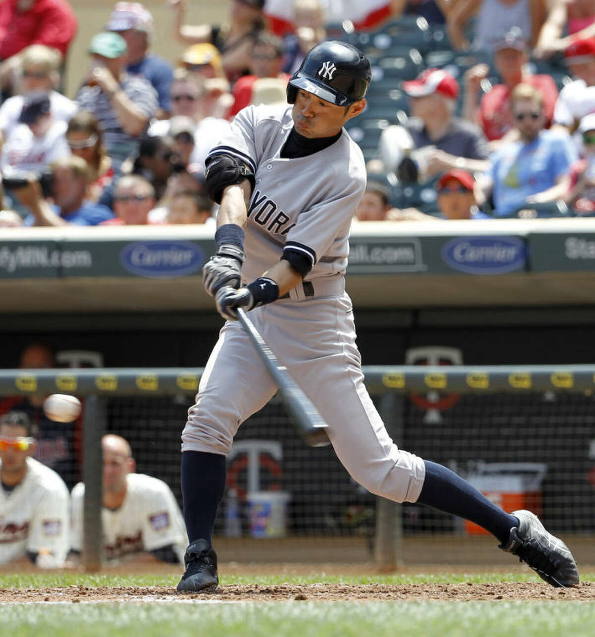 New York Yankees' Ichiro Suzuki, of Japan, hits a grounder off Minnesota Twins starting pitcher Yohan Pino during the fifth inning of a baseball game in Minneapolis, Saturday, July 5, 2014. Carlos Beltran was out at second. (AP Photo/Ann Heisenfelt)