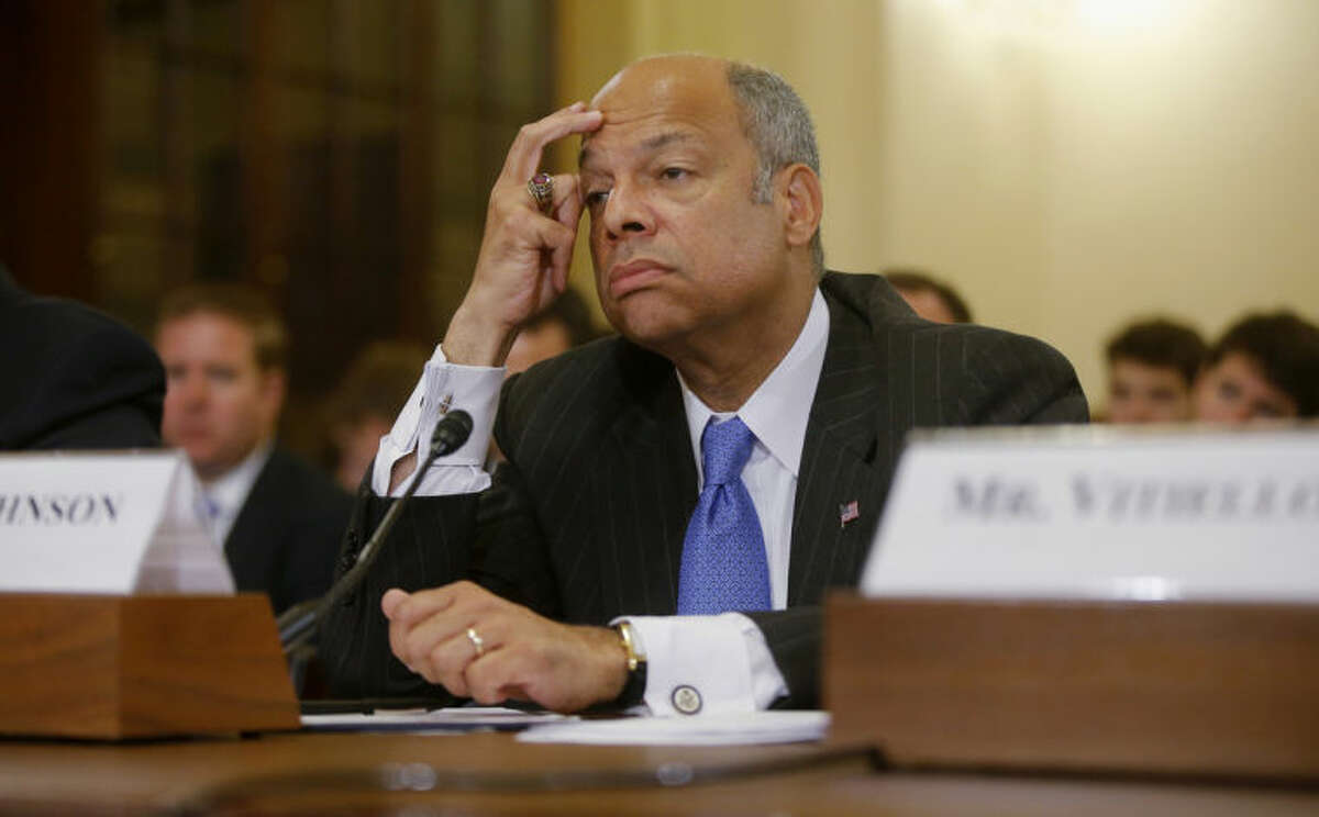 FILE - This June 24, 2014, file photo shows Homeland Security Secretary Jeh Johnson listens while testifying on Capitol Hill in Washington before the House Homeland Security Committee hearing about the growing problem of unaccompanied children crossing the border into the US. On NBC's