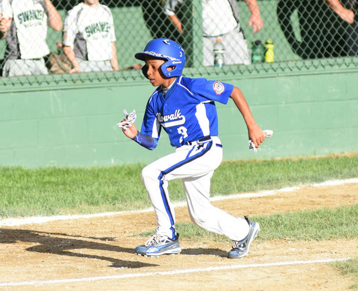 Hour photo/John Nash - Action from Wednesday's loser's bracket final between Norwalk and Swanzey, N.H., at the New England Regional 11-year-old Cal Ripken Tournament in Dover, N.H. Norwalk won, 4-3, to advance to the regional championship game.