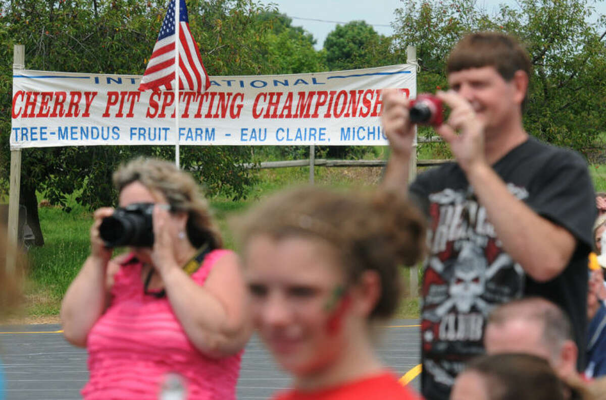 Fans watch during the 41st International Cherry Pit-Spitting Championship on Saturday, July 5, 2014, at Tree-Mendus Fruit Farm in Eau Claire, Mich. (AP Photo/The Herald-Palladium, Don Campbell)