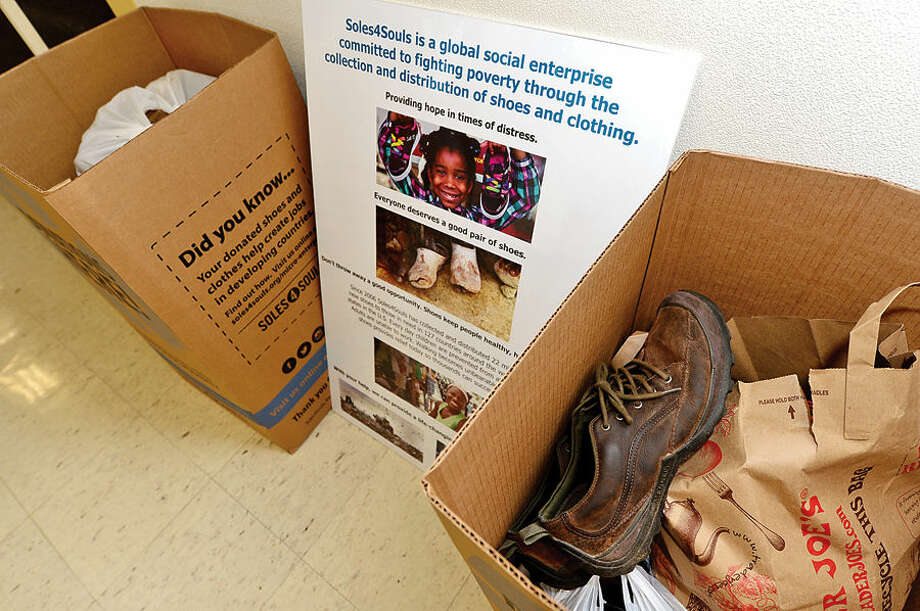 Hour photo / Erik Trautmann The Westport Town Hall hosts a Soles4Souls campaign. Soles4Souls is a global social enterprise committed to fighting poverty through the collection and distribution of shoes and clothing.