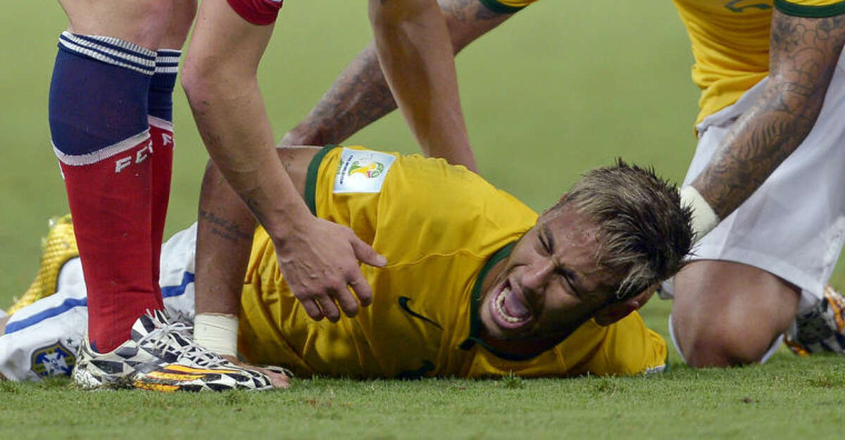 In this July 4, 2014, photo, Brazil's Neymar screams out after being fouled during the World Cup quarterfinal soccer match between Brazil and Colombia at the Arena Castelao in Fortaleza, Brazil, Friday. The 22-year-old Neymar broke his third vertebra after being kneed in the back by Colombian player Juan Camillo Zuniga in the 86th minute of the match. (AP Photo/Manu Fernandez)