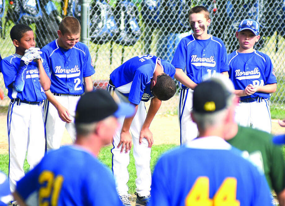 Hour photo/John Nash - Norwalk players react as Newtown is congratulated after winning the 2015 New England Regional Cal Ripken 11-year-old championship at Beckwith Park's Keyes Field in Dover, N.H., on Thursday afternoon.