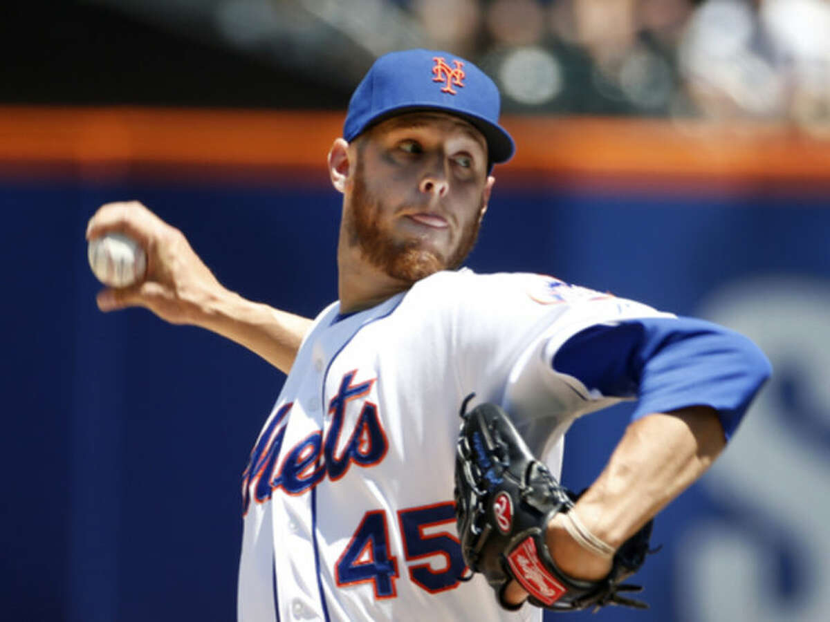 New York Mets starting pitcher Zack Wheeler delivers in the first inning of a baseball game against the Texas Rangers in New York, Sunday, July 6, 2014. (AP Photo/Kathy Willens)