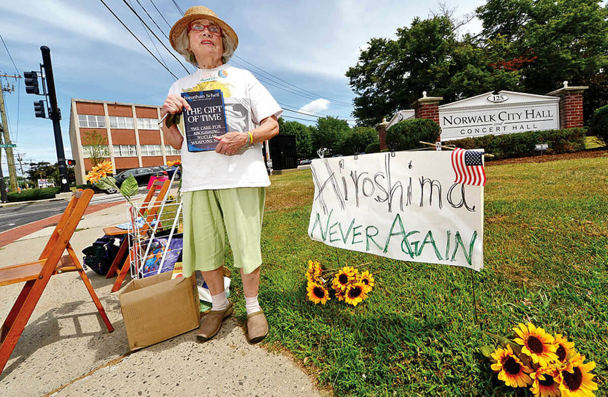 Hour photo / Erik Trautmann Missy Conrad of the Connecticut Friends (Quakers) holds vigil outside of City Hall to protest the use of nuclear weapons on the 70th anniversary of the Aug. 6, 1945 atomic bombing of Hiroshima.