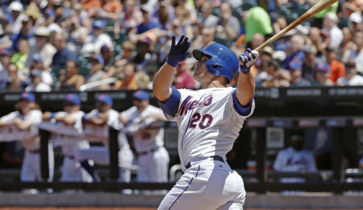 New York Mets Anthony Recker hits a first-inning three-run home run off Texas Rangers starting pitcher Nick Tepesch in a baseball game in New York, Sunday, July 6, 2014. (AP Photo/Kathy Willens)