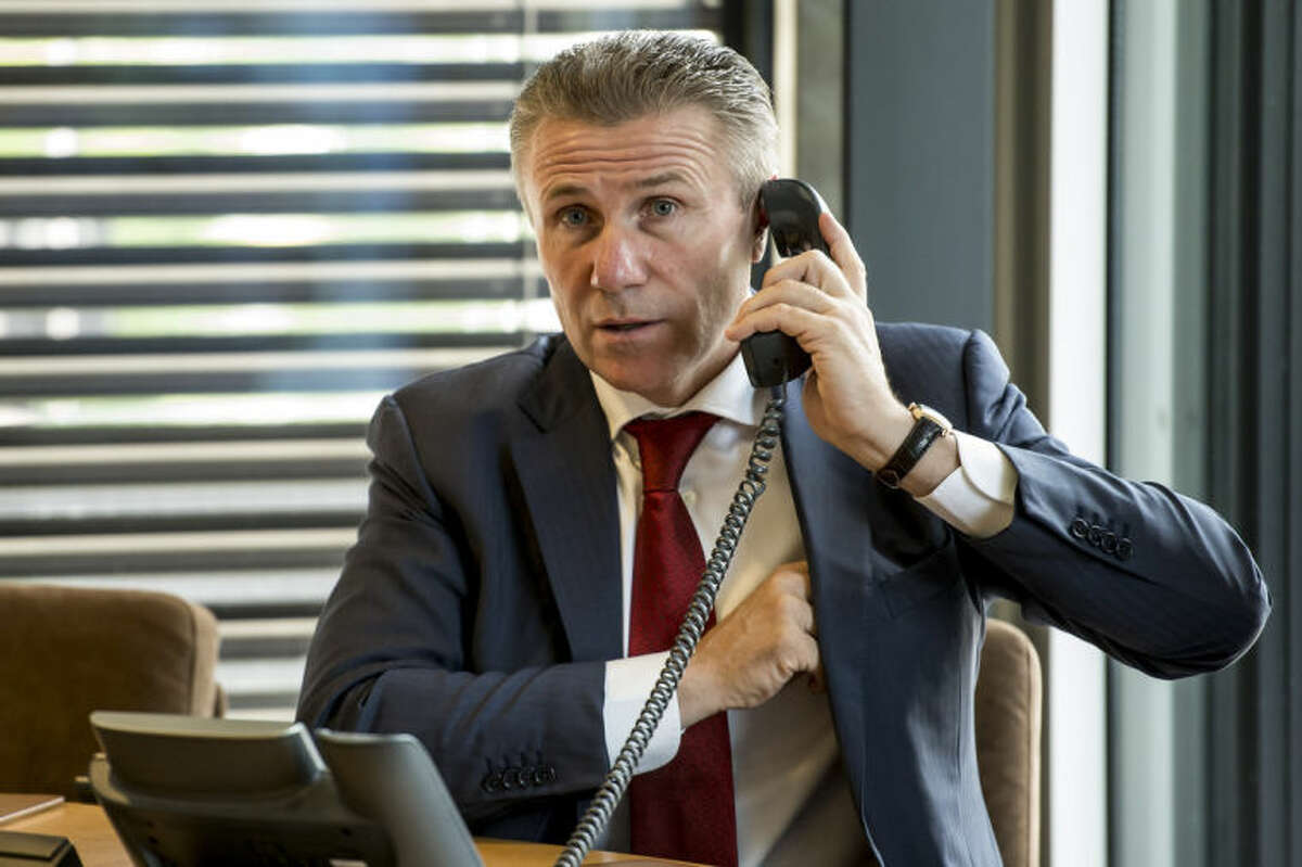 Member of the International Olympic Committee, IOC, Sergei Bubka of Ukraine, speaks on the phone prior to the opening of the executive board meeting at the IOC headquarters in Lausanne, Switzerland, on Monday, July 7, 2014. (AP Photo/Keystone,Jean-Christophe Bott)