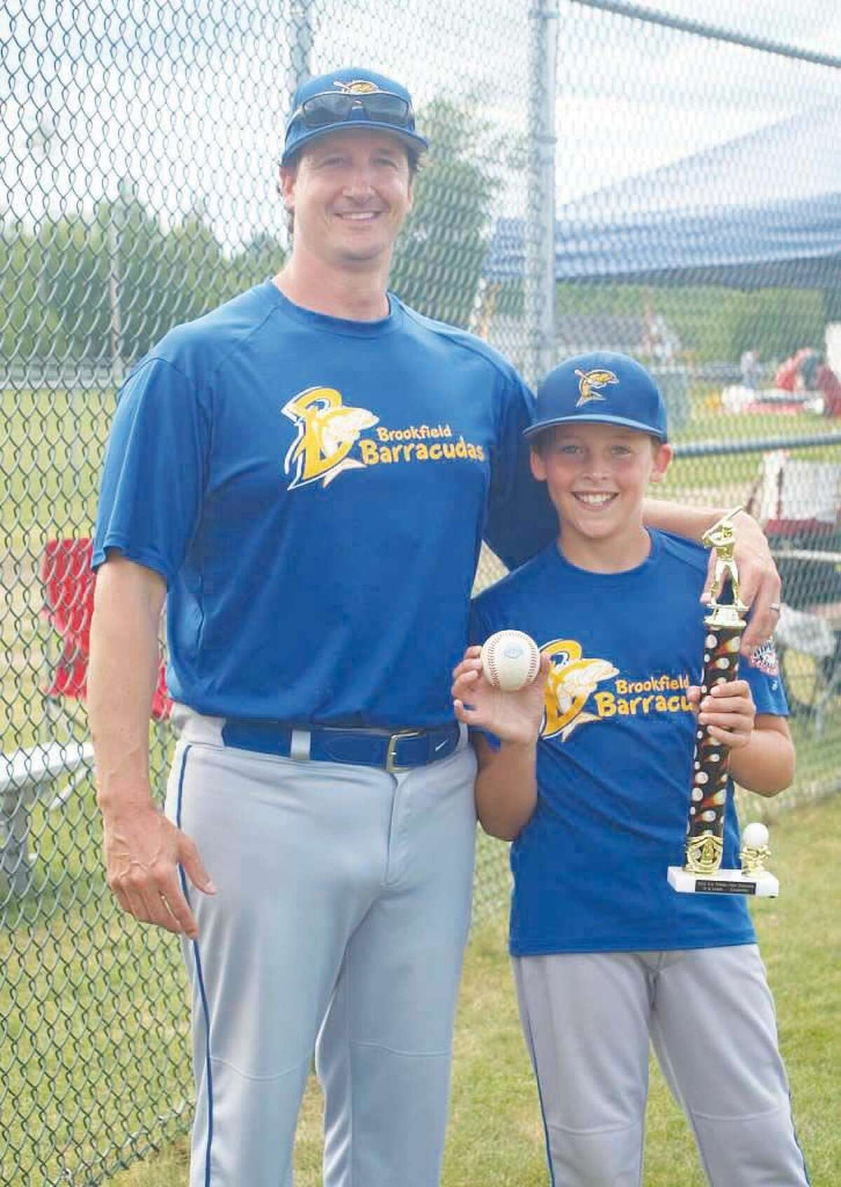Former Norwalk High baseball standout Craig Katz, once the city's all-time hits leader, stands with his son Casey after their Brookfield Cal Ripken 10 year-old all-star team won the New England Regionals. (Contributed photo)