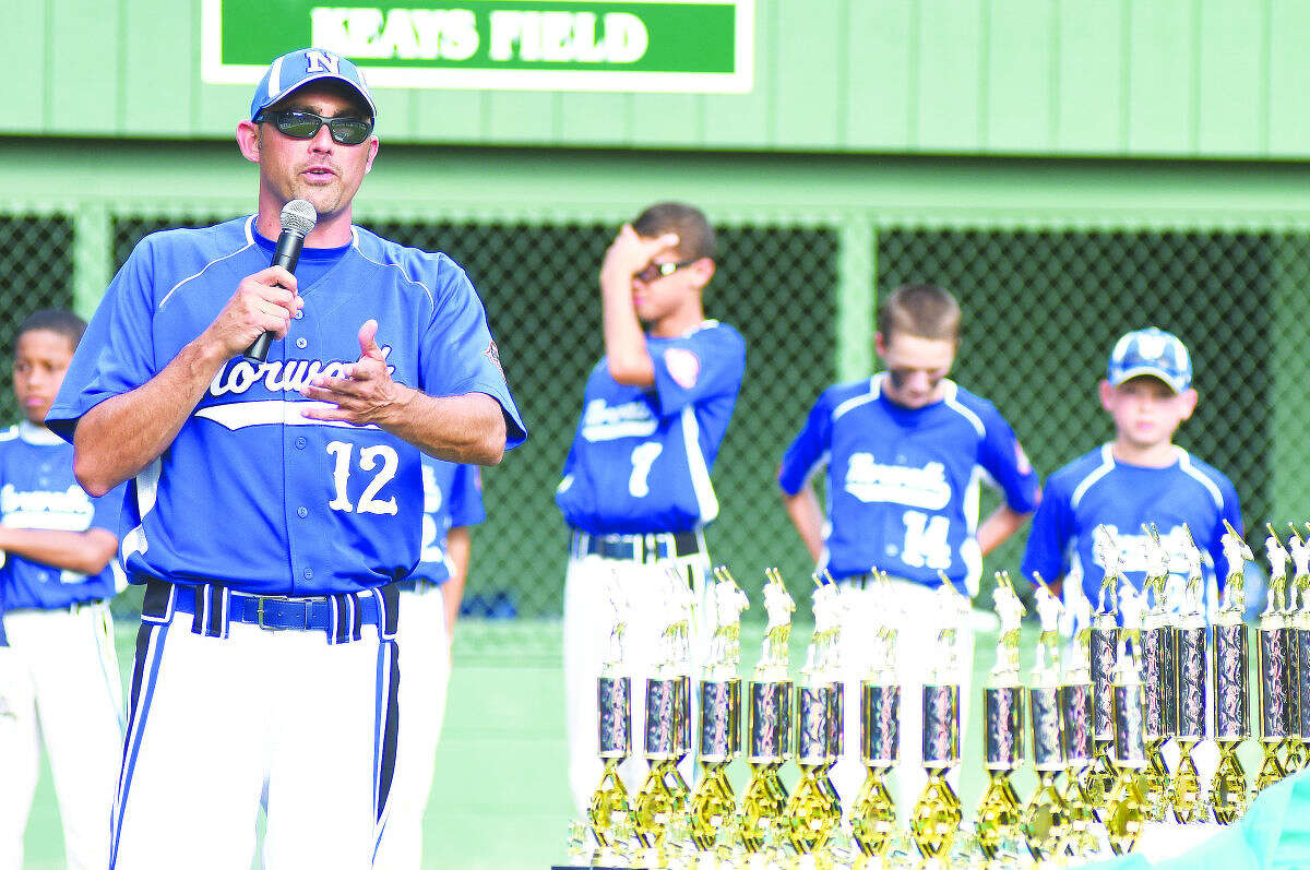 Hour photo/John Nash - Norwalk Cal Ripken 11-year-old All-Star players react as head coach Mark Boccanfuso congratulates Newtown on winning the 2015 New England Regional Championship, 6-5, at Beckwith Park's Keyes Field in Dover, N.H., on Thursday afternoon.